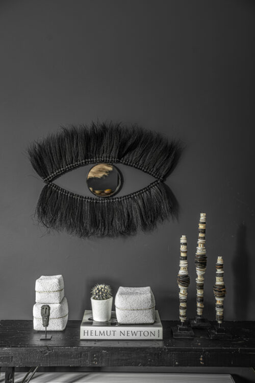 decoration on black wall and table with beaded baskets
