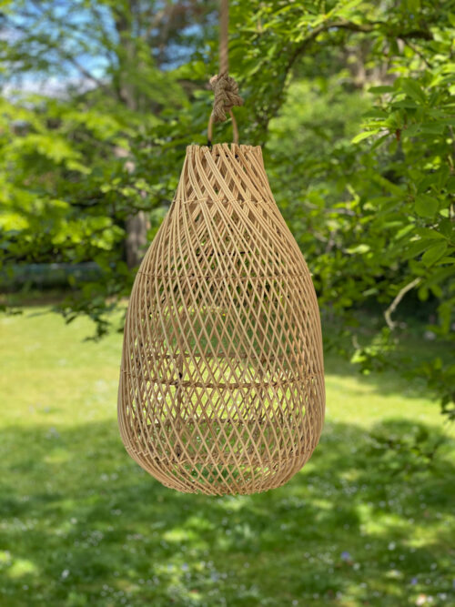 hanging natural woven lamp in tree