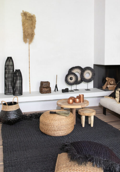 decor of baskets, lamps, stools, pillows in black, white and natural colours