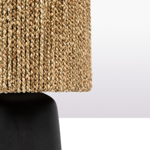 detail of black lamp with seagrass