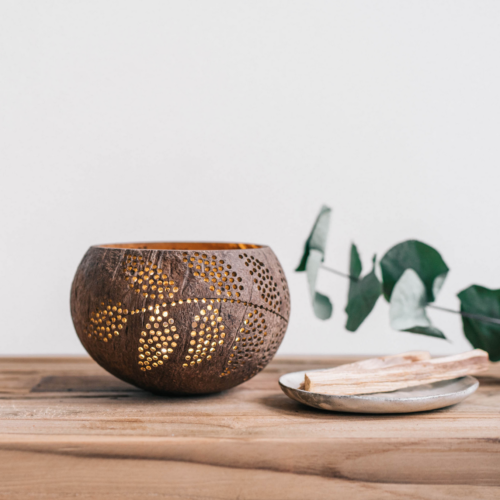 plantlover candleholder made from coconut shell on table