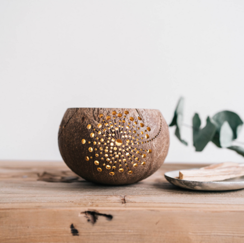 sunshine candleholder made fro coconut shell on table