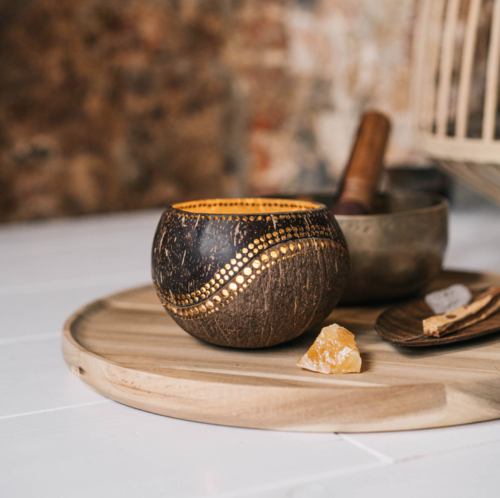 yinyang candleholder made from coconut on woodenplate