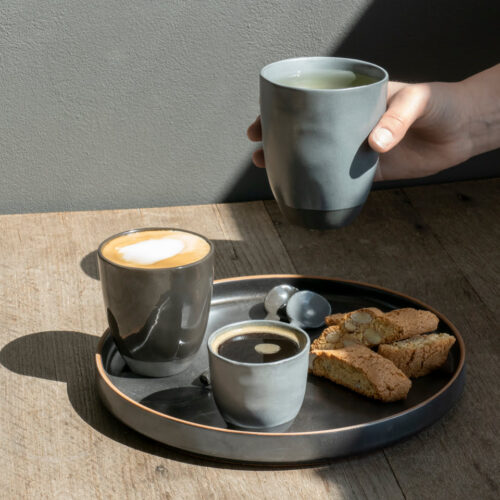 tray with coffee and cookies on wooden table