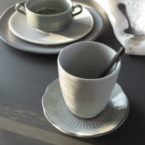 table setting with cups and plates