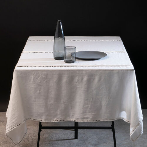 white set table with still life made of plate, jug and glass
