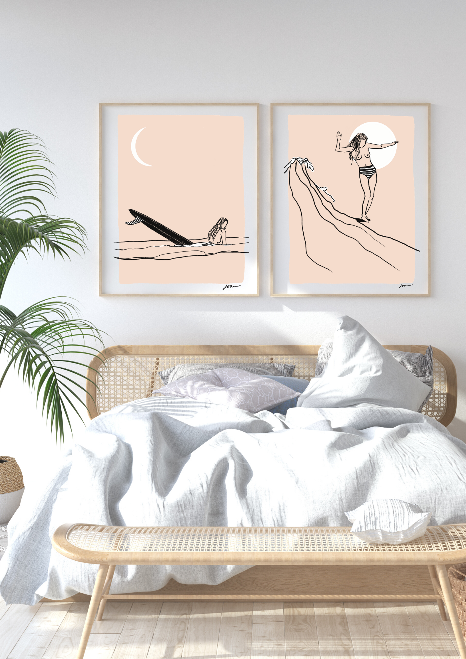 two prints of surfgirls in frame on wall
