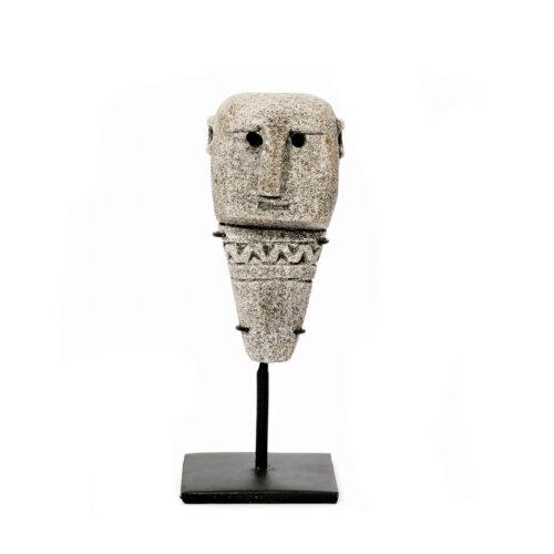 gray sandstone man figurine on black stand on white background