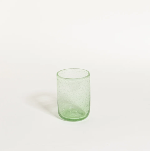 Transparent bubble glass on white background in lime color