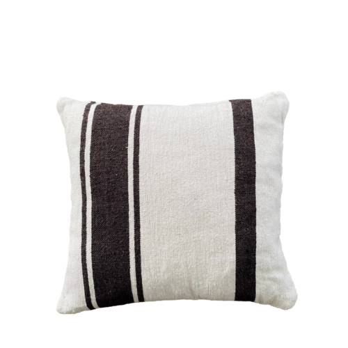 ecru square cushion with brown stripes on a white back