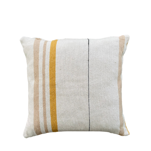 ecru square cushion with gold and sand stripes, photographed on a white background